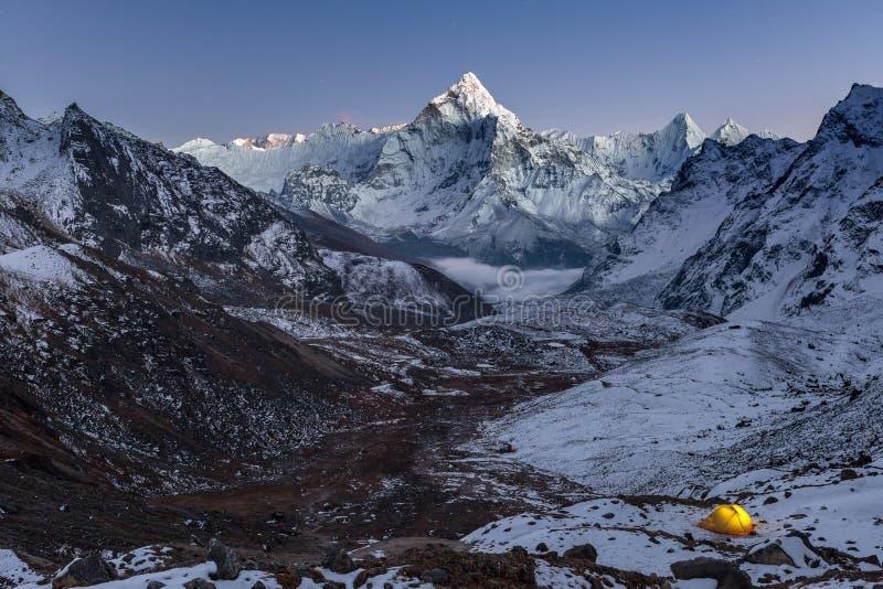 Night camping near amazing Ama Dablam peak in. royalty free stock photo