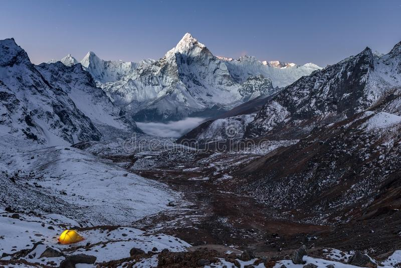 Night camping near amazing Ama Dablam peak in. royalty free stock photography