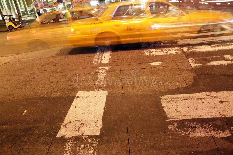 Night capture of a taxi in New York City stock image