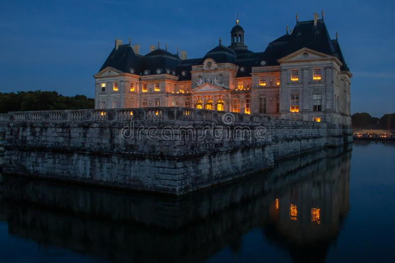 Chateau at Vaux-le-Vicomte at night. At night Chateau at Vaux-le-Vicomte is lit only by candlelight stock images