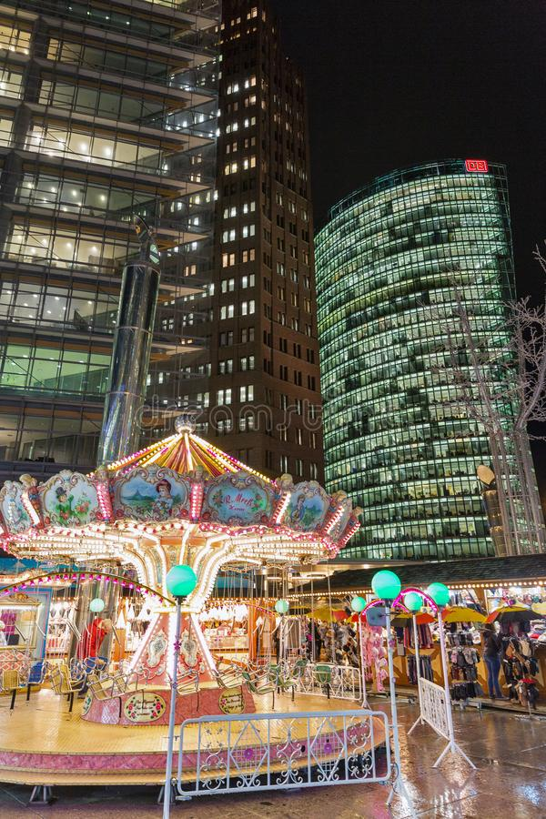 Night Christmas market with carousel on Potsdamer Platz. Berlin, Germany royalty free stock photography