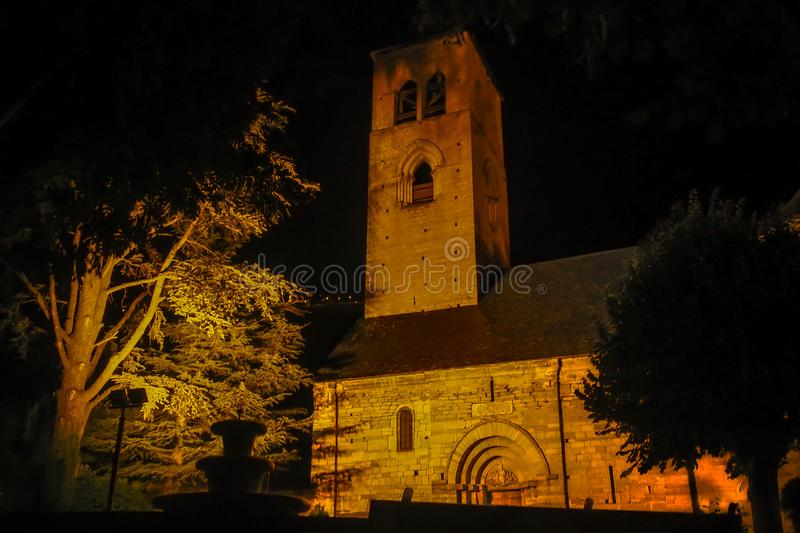 Night church of Vilach. In the Catalan Pyrenees is located this Catholic church in the municipality of Vilach, next to Vielha tourist area dedicated to hiking stock photography