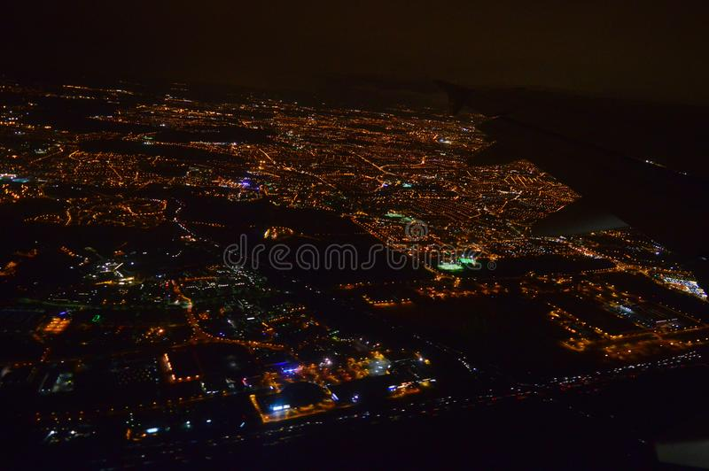 Night city from an airplane in flight at night stock photo