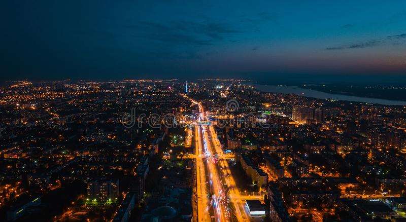Night city central road. Night cityhouses and central highway, aerial view stock images