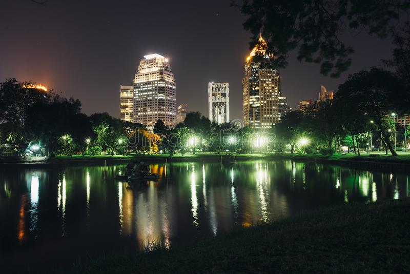 Night city. Cityscape, urban landscape. Lumpini Park Bangkok royalty free stock photo
