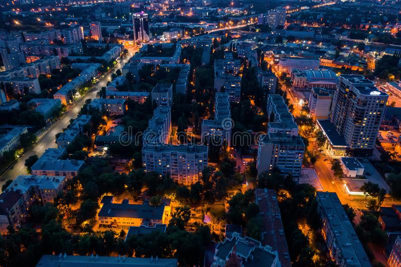 Night City downtown or center panorama from above with illuminated road intersection, car traffic, aerial view stock photography