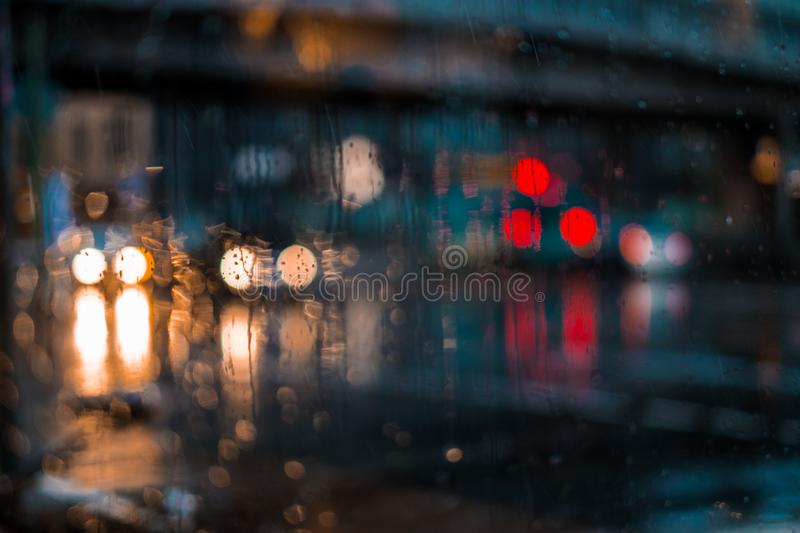 Night city life through windshield: cars, lights and rain royalty free stock photography
