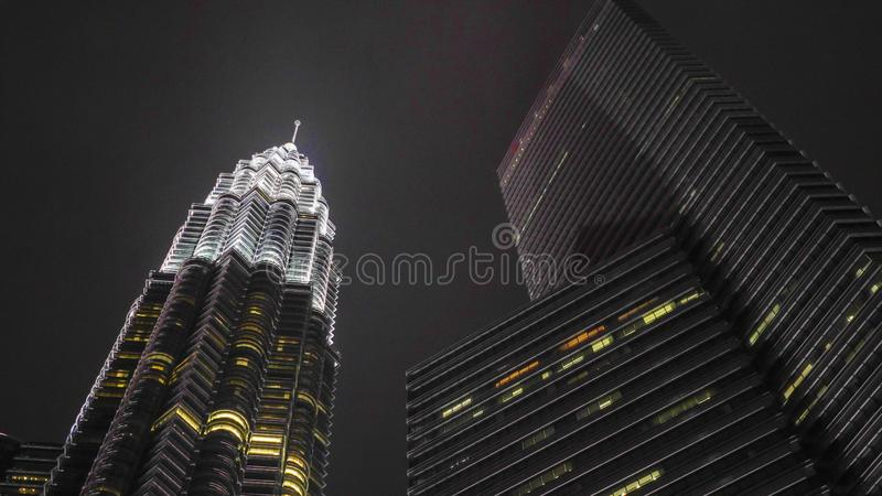 Night city lights. Beautiful view of the stunning Petronas Tower emerging majestic over KLCC district stock photography