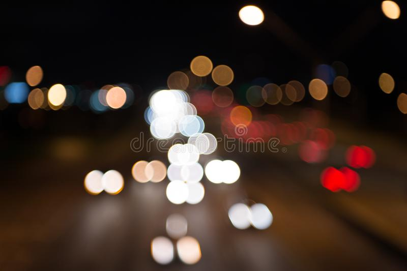 Night city lights. Illumination and lighting. White and red blurred lamps. Watching transport moving in street. Urban royalty free stock photos