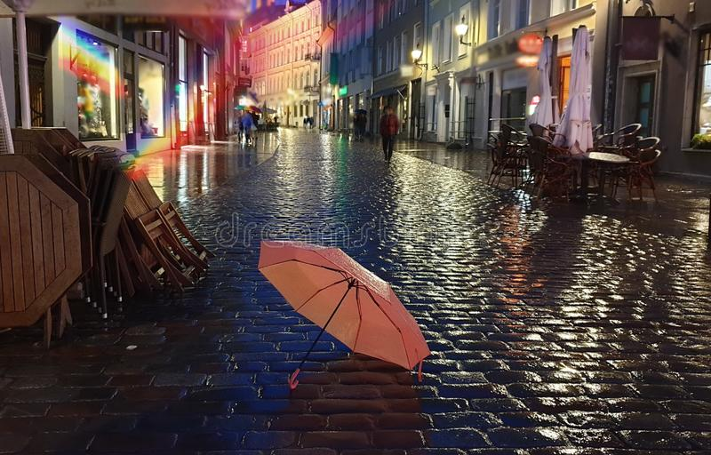 Night City Lights Rainy Season weather Autumn evening in city street bokeh light rainy night umbrella. Street cafe tables ,Autumn evening in city street cafe cup stock photography