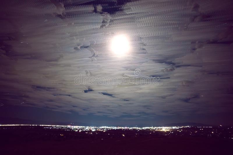 Night city.Moving clouds Night view of the city. stock images