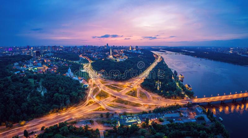 Night city panorama of the Kiev city with the Paton Bridge and the Dnieper River. Ukraine. Skyline of Kyiv. Beautiful night city panorama of Kiev with the Paton royalty free stock photography