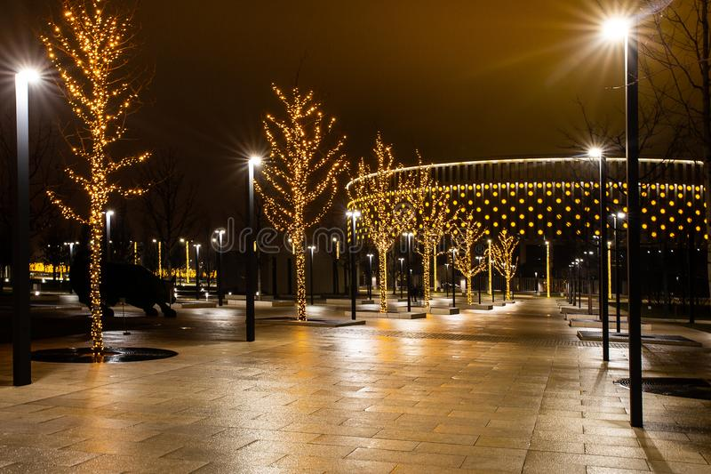 Night city park in the city of Krasnodar, Russia. The park is made in the same design style and contains a lot of geometry and. Rhythms. Stadium Krasnodar holds royalty free stock photo