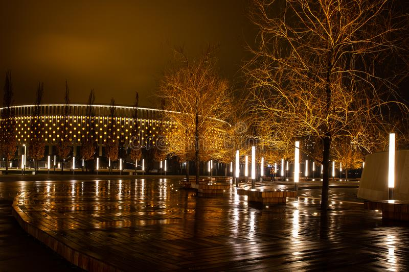 Night city park in the city of Krasnodar, Russia. The park is made in the same design style and contains a lot of geometry and. Rhythms. Stadium Krasnodar holds royalty free stock image