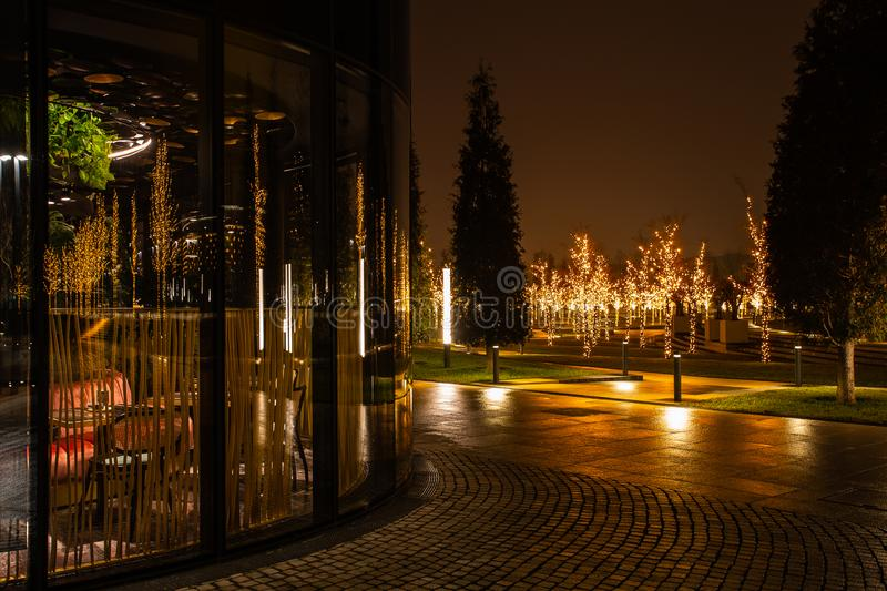 Night city park in the city of Krasnodar, Russia. The park is made in the same design style and contains a lot of geometry and. Rhythms. Stadium Krasnodar holds stock image
