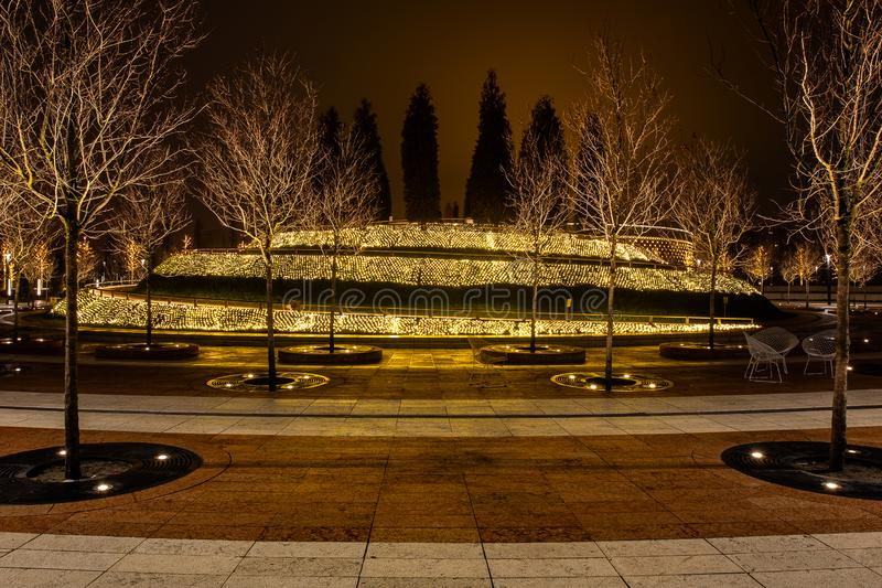 Night city park in the city of Krasnodar, Russia. The park is made in the same design style and contains a lot of geometry and. Rhythms. Stadium Krasnodar holds stock photos