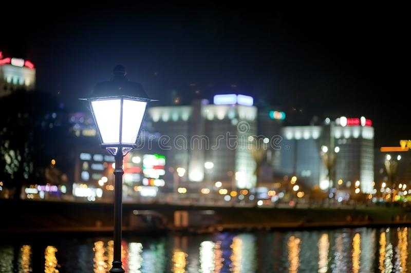 Night city by the river. Beautiful view of the metropolis for the background, Belarus, Minsk, Nemiga street stock image
