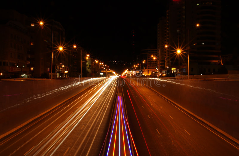 Night city road. Lights, cars, buildings, highway, traffic royalty free stock photography
