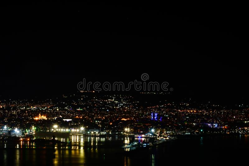 Night city scene. А Night view of a city with reflections of the lights on the water of the sea, Varna, Bulgaria ,black sea stock photo