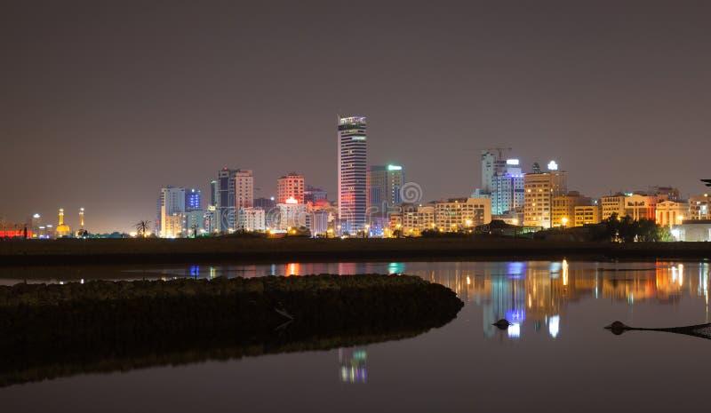 Night city skyline. Manama, the Capital of Bahrain Kingdom. Night city skyline, shining lights and reflections in water. Manama, the Capital of Bahrain Kingdom stock images
