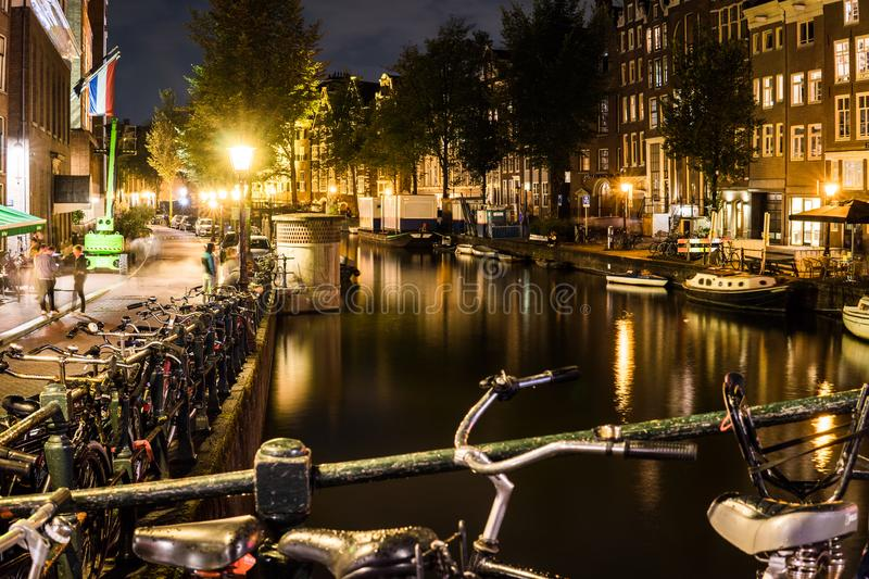 Night city view of Amsterdam bridge and typical dutch houses, Holland, Netherlands. stock photo