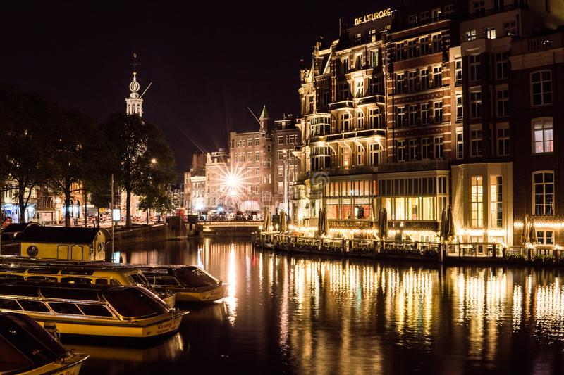 Night city view of Amsterdam channel and typical dutch houses, Holland, Netherlands. stock photo