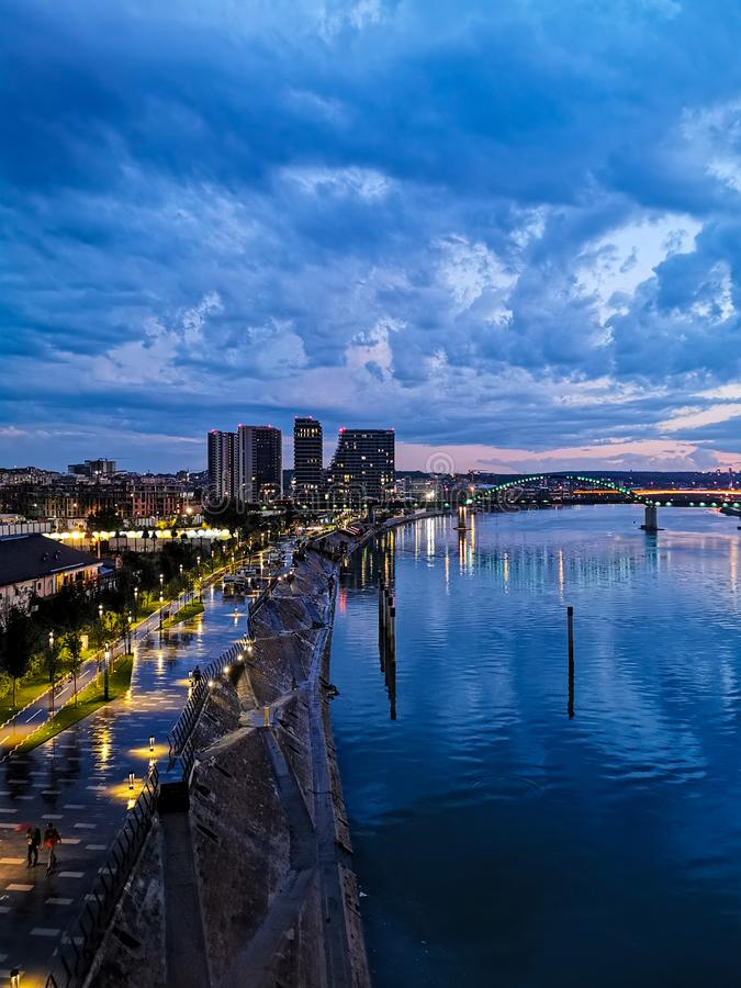 Night city view in Belgrade, Serbia. Lights, cityview, waterfront, beograd, embankment, nightcity, houses, atchitecture, sky, clouds, evening royalty free stock photography