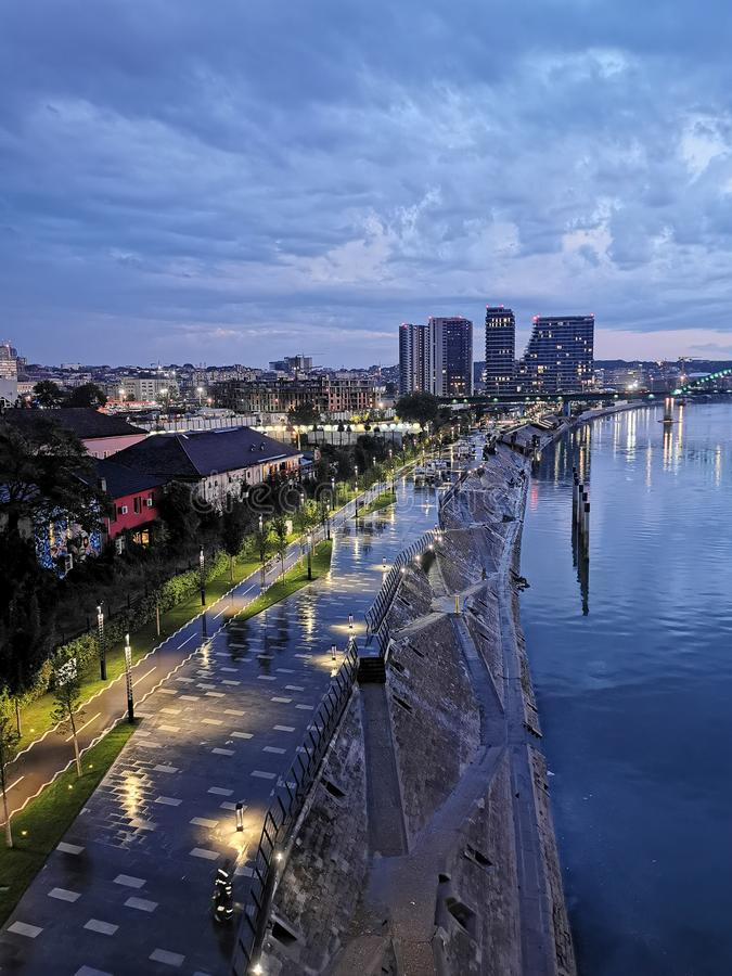 Night city view in Belgrade, Serbia. Lights, cityview, waterfront, beograd, embankment, nightcity, houses, atchitecture, sky, clouds, evening royalty free stock photo