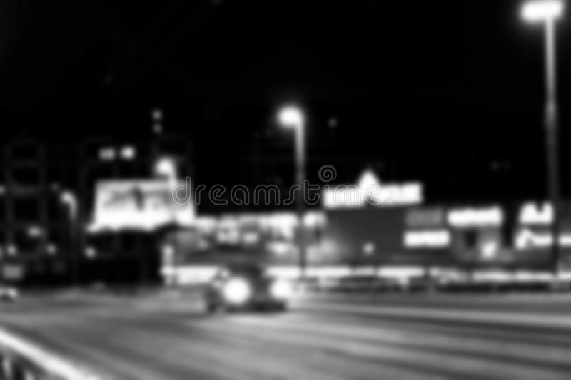 Night city view in blur. City Speed Traffic lights blurry photo. Street life bokeh image. Street with traffic and cars defocused i royalty free stock photography