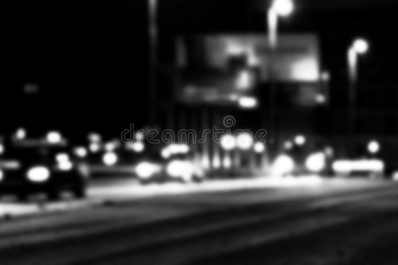 Night city view in blur. City Speed Traffic lights blurry photo. Street life bokeh image. Street with traffic and cars defocused i. Mage. Road in big city bokeh royalty free stock image