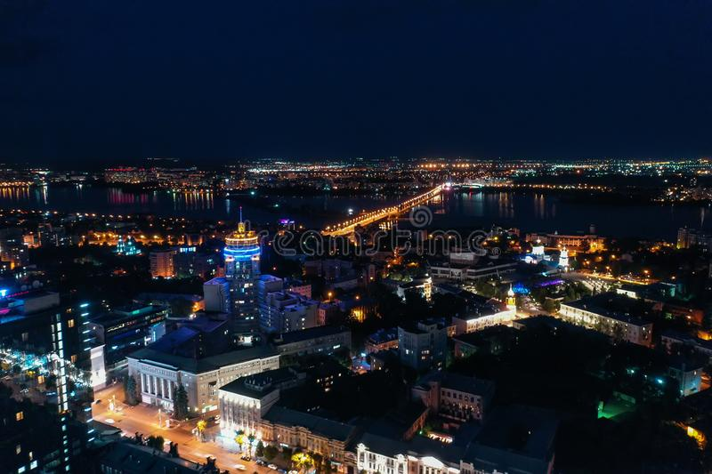 Night City Voronezh downtown or center panorama from above with illuminated road intersection, car traffic, modern stock image