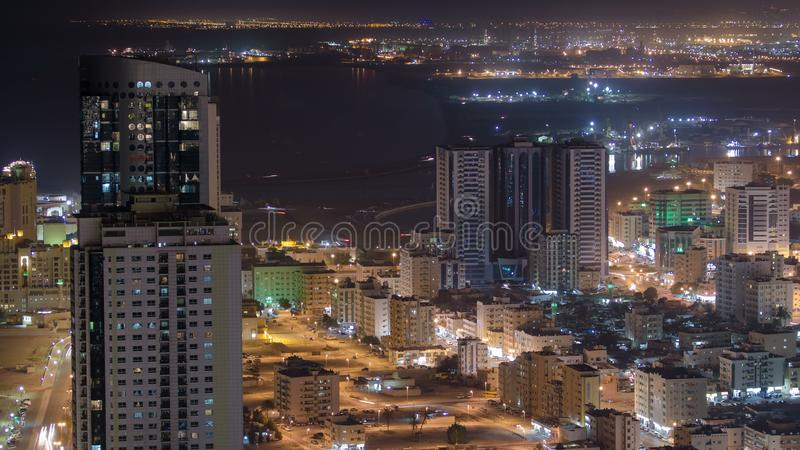 Cityscape of Ajman from rooftop at night timelapse. Ajman is the capital of the emirate of Ajman in the United Arab Emirates. stock photography