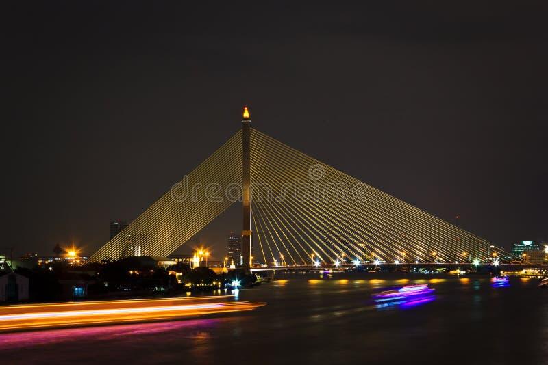 Bridge. Night cityscape, main bridge with many boats at Thailand stock images