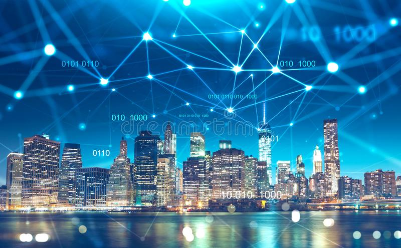 Night cityscape with digital technology network stock image