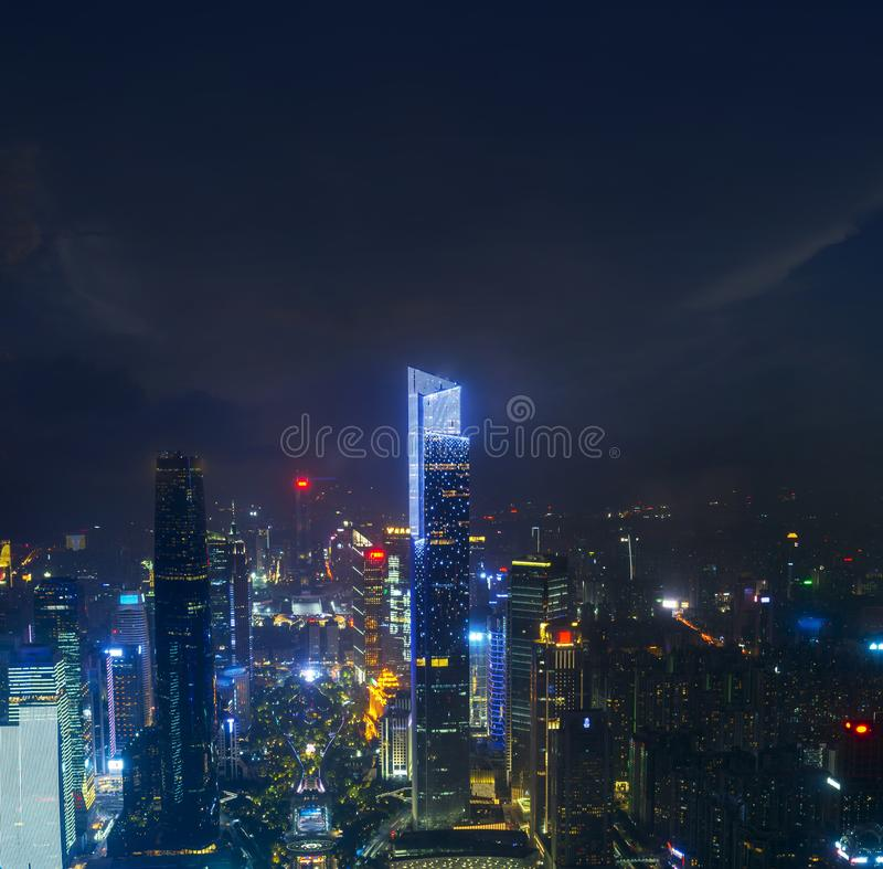 Night cityscape of guangzhou urban skyscrapers at storm with lightning  bolts in night purple blue sky, Guangzhou, China. Thunderstorm weather dark energy scene royalty free stock image