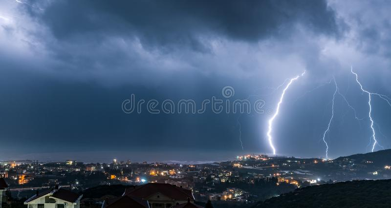 Night cityscape with lightning over it stock images