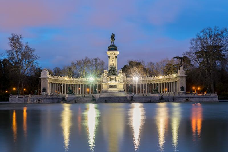 Night cityscape with lights at the memorial in Retiro city park, Madrid, Spain royalty free stock images