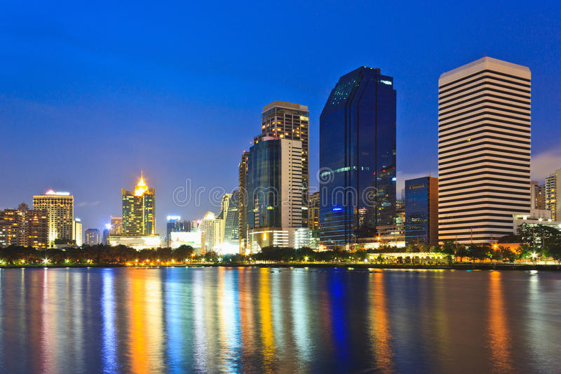 Night Cityscape. Office buildings and apartments in Thailand at dusk. View from public park royalty free stock image