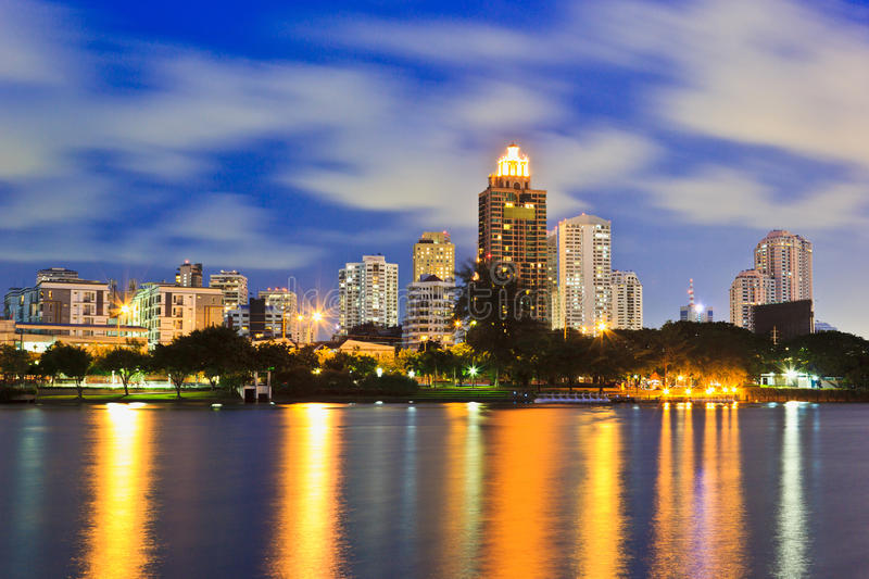 Night Cityscape. Office buildings and apartments in Thailand at dusk. View from public park stock photography