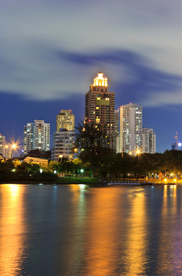 Night Cityscape. Office buildings and apartments in Thailand at dusk. View from public park stock photo