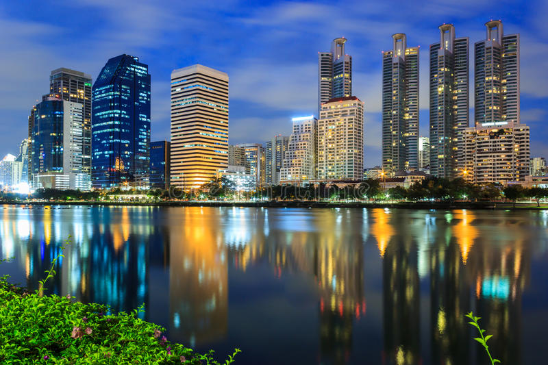 Night Cityscape. Office buildings and apartments in Thailand at dusk. View from public park stock photos