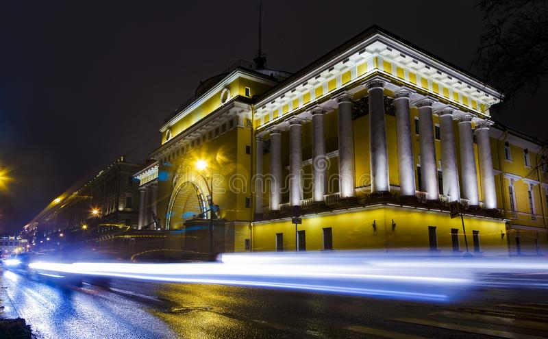 Night cityscape with traffic lights, car`s light, the admitalty building and palace embankment. Saint Petersburg Russia stock photography