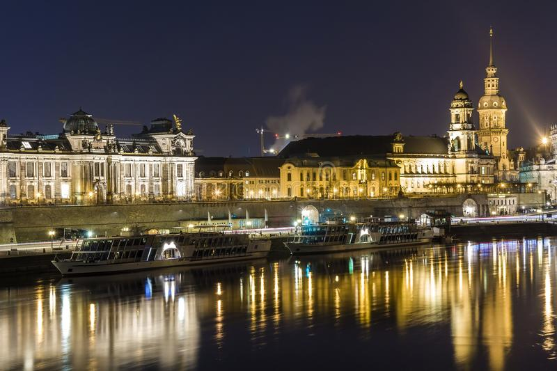 Night cityscape view of historic buildings with reflections in E. Lbe river in the center of Dresden & x28;Germany& x29 stock photography