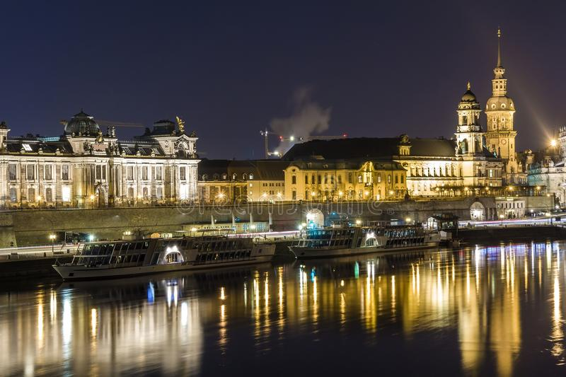 Night cityscape view of historic buildings with reflections in Elbe river in the center of Dresden Germany. Night cityscape view of historic buildings with stock photography