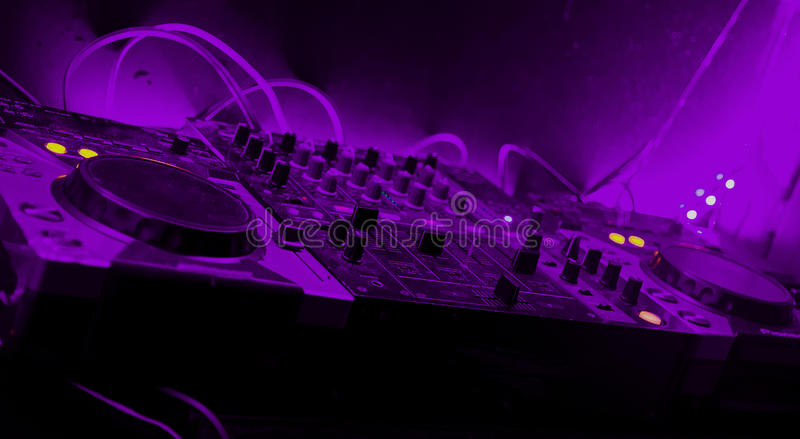Night club mixing table with lights stock photography