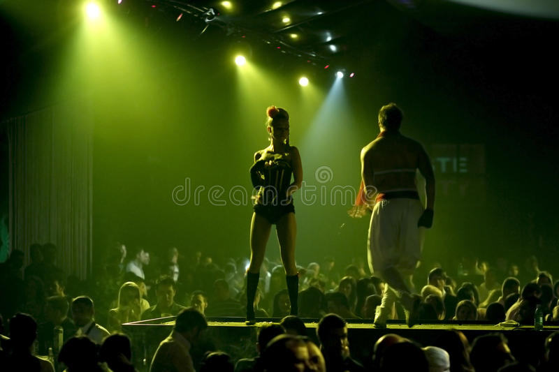 Night club scene with dancers and lights show royalty free stock photography