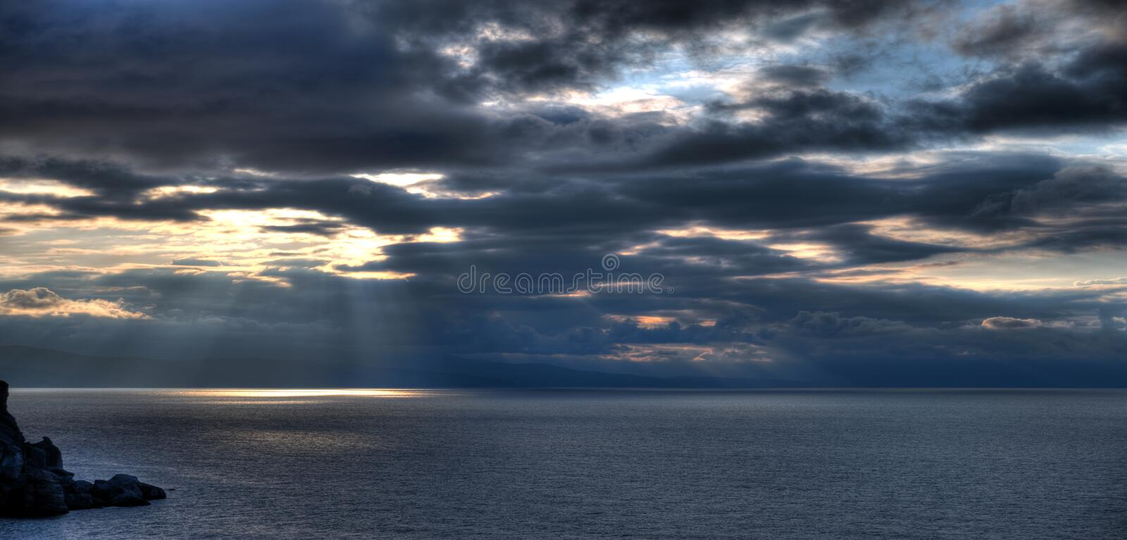 The night coastline and mountains royalty free stock photo