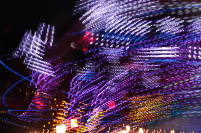 synthwave disco lights funfair fairground Night colors of the amusement park royalty free stock image