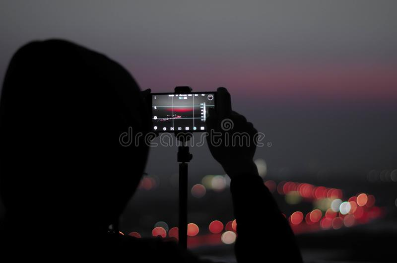 A photographer on the roof royalty free stock photography