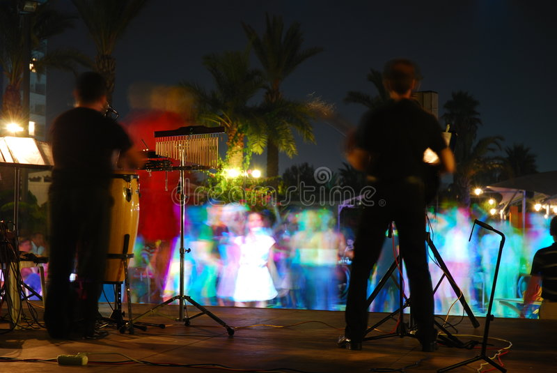 Night concert 2. Night concert and dancing people royalty free stock photos
